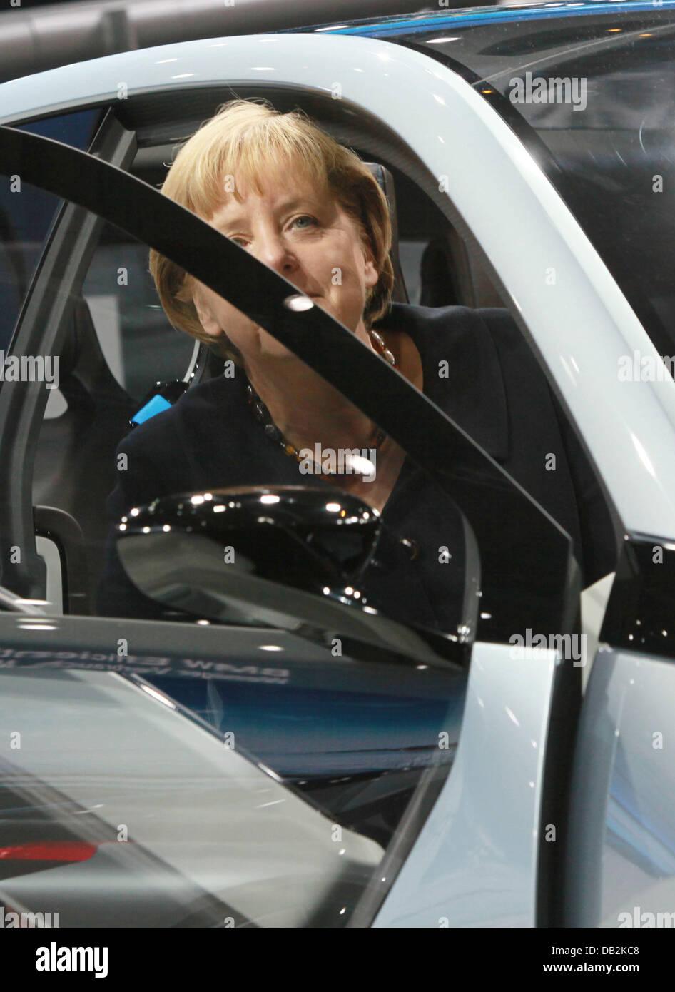 German Chancellor Angela Merkel Sits Inside A Bmw I3 Concept