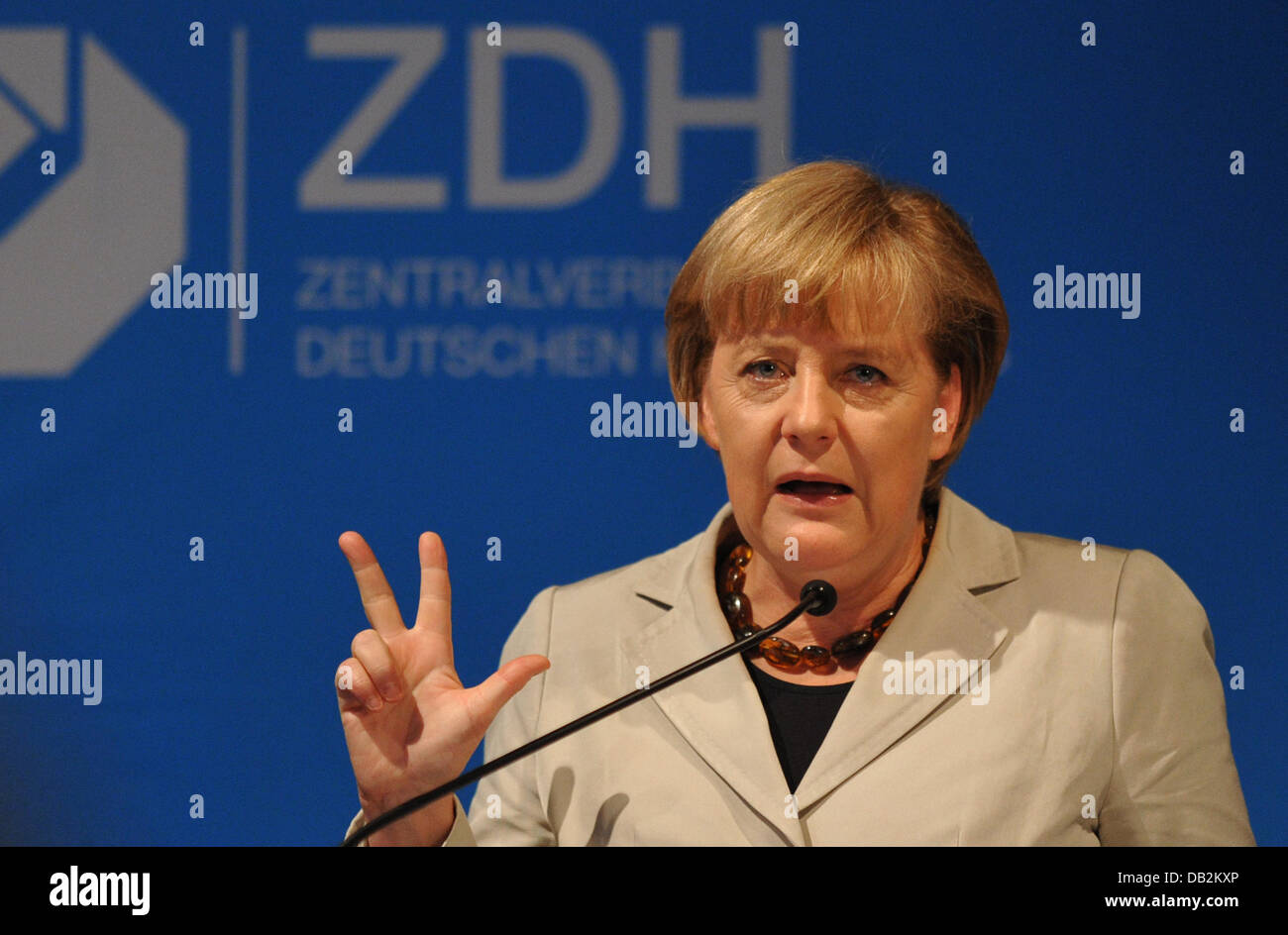 German Chancellor Angela Merkel speaks during the forum of the German Central Crafts Union in Berlin, Germany, 16 - Stock Image