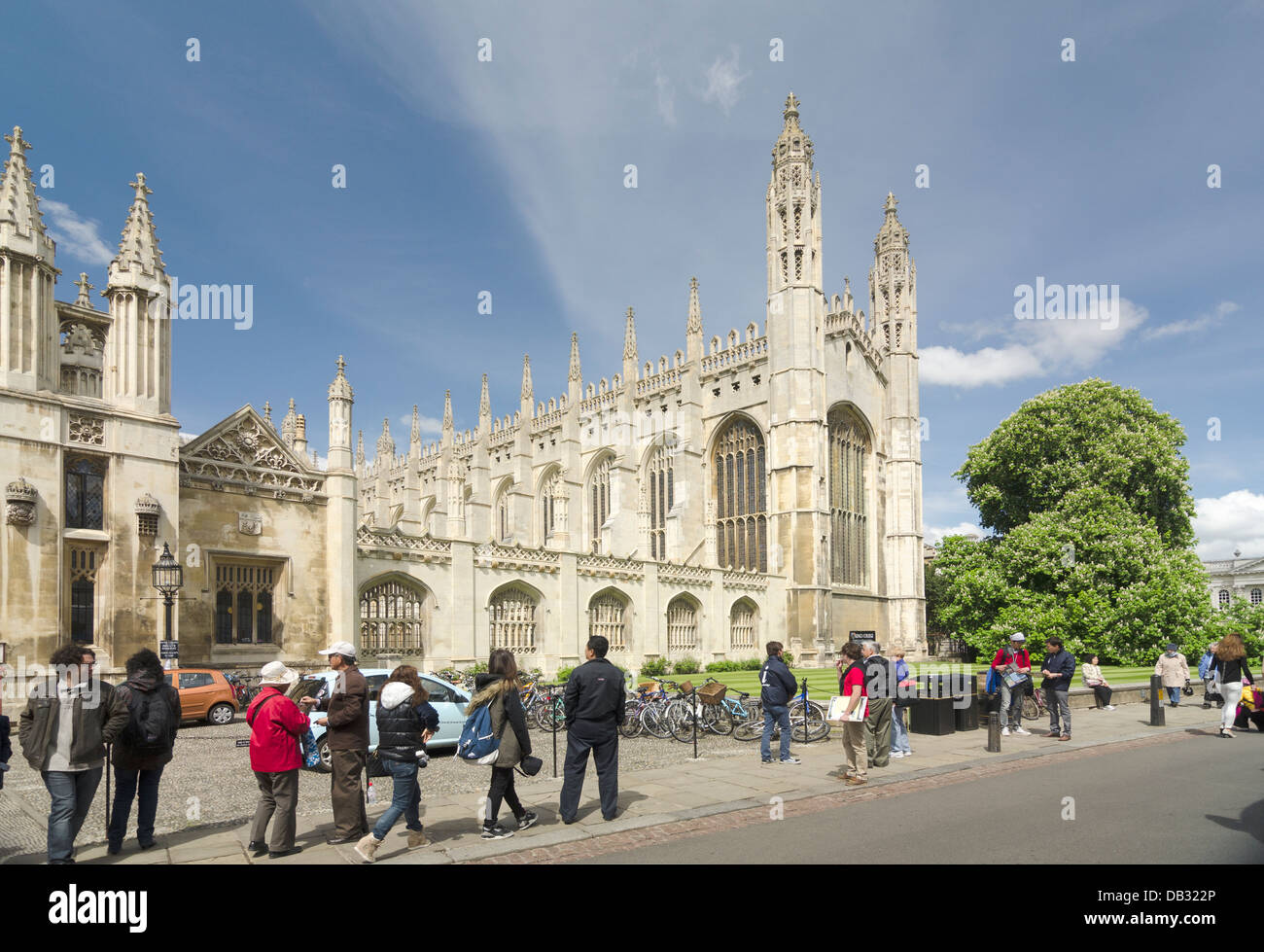 tourists, visitors and tour guides by King's College Cambridge UK - Stock Image