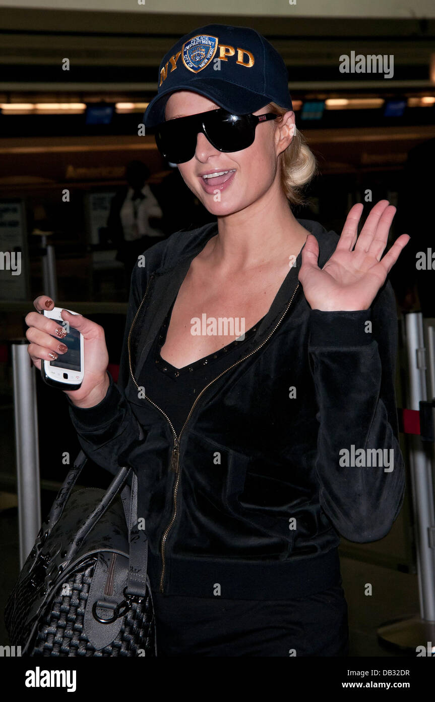 Paris Hilton leaves JFK Airport for LAX in a NYPD police baseball cap New  York City 5a19373aa62a