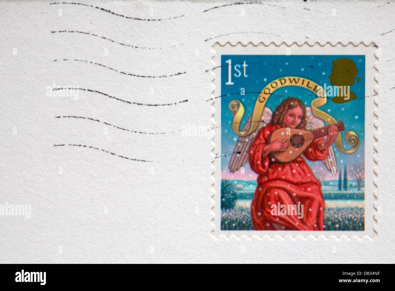 1st class the Angel of Goodwill Christmas stamp stuck on white envelope - Stock Image