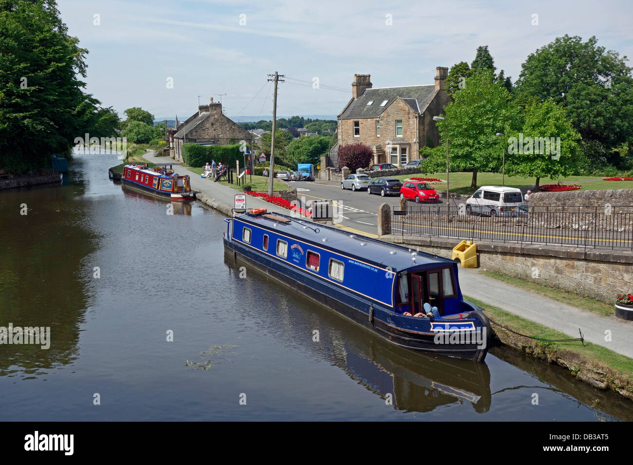Canal boats Marine Cruises Debbie II and Charter Hotel Boat  Willow moored in the Union Canal at Linlithgow Scotland - Stock Image