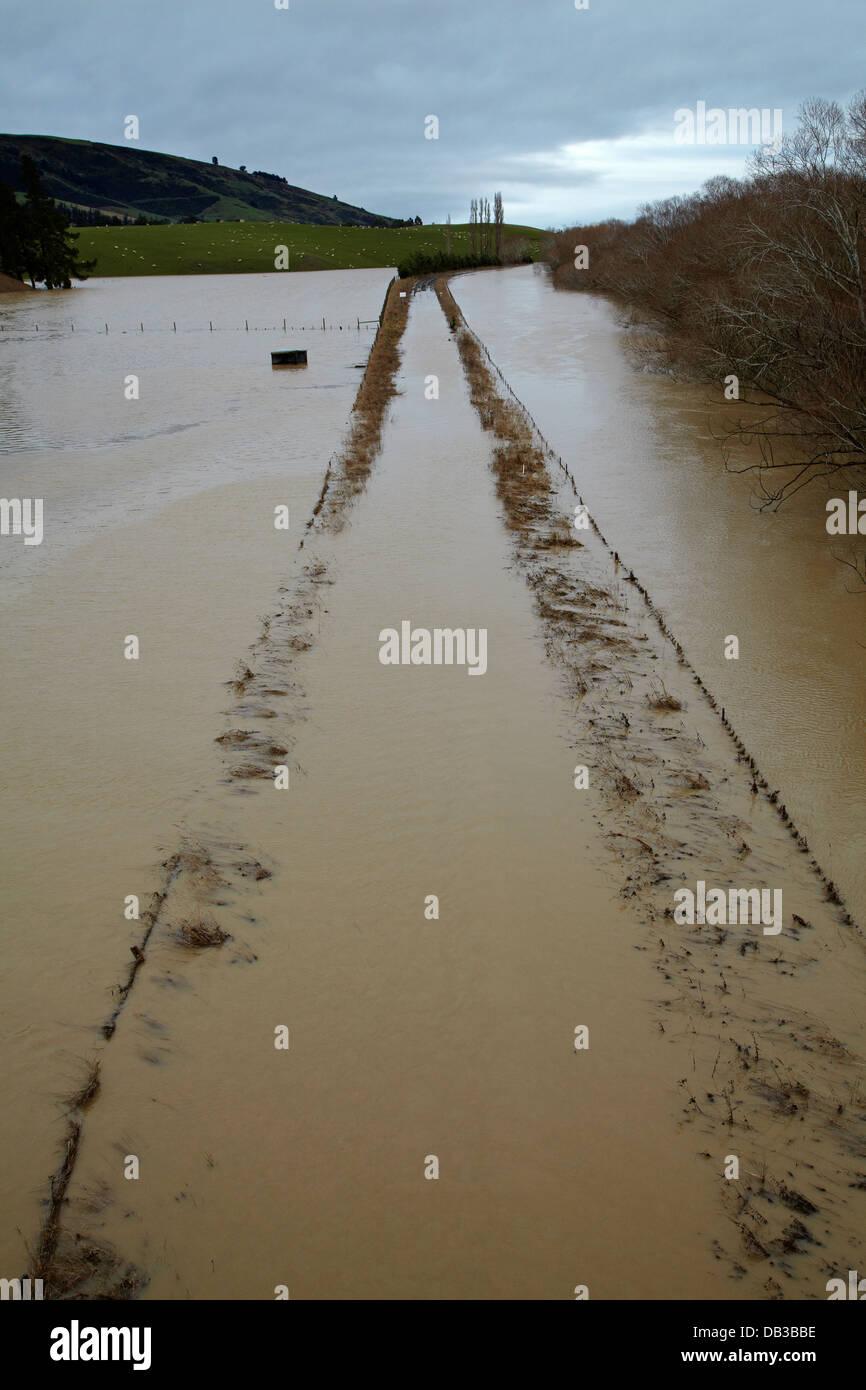Railway lines at Allanton, flooded by Taieri River, Taieri Plains, near Dunedin, South Island, New Zealand - Stock Image