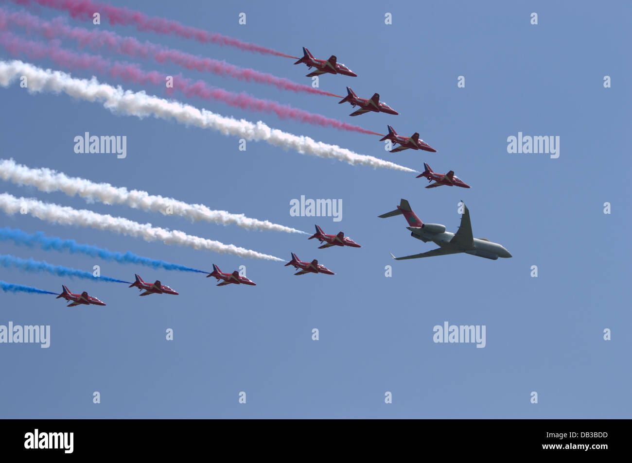 The RAF Red Arrows flyby with the RAF Raytheon Sentinel - Stock Image
