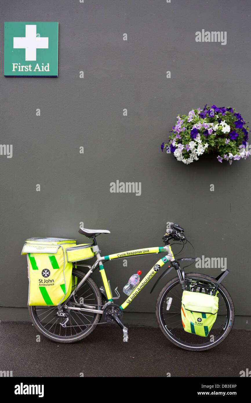 St Johns Ambulance First Aid station with response bike - Stock Image