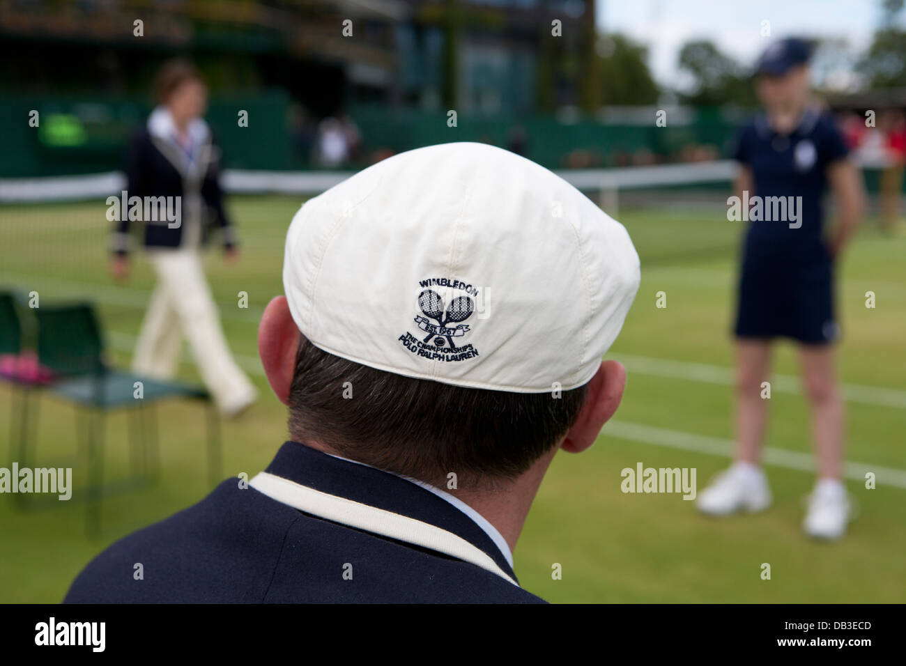 Ralph Lauren logo on line judges cap The Championships Wimbledon 2012 - Stock Image