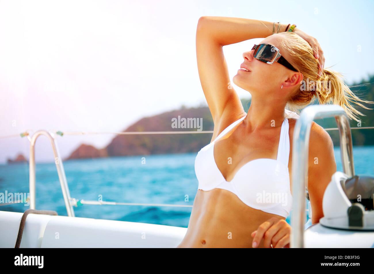 Beautiful Girl resting on the Yacht. Yachting. Luxury Lifestyle - Stock Image