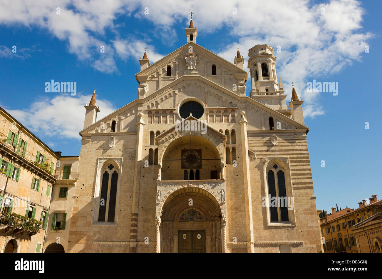 Angle facade shot of cathedral of Verona named Santa Maria Matricolare in a bright sunny day over blue sky. - Stock Image