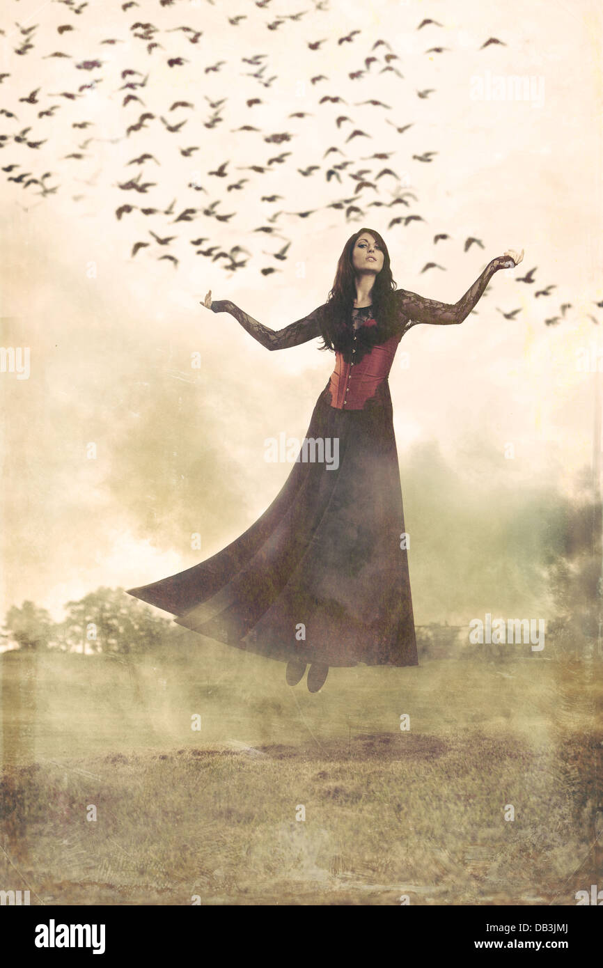 Woman Floating Through Air With Smoke And Birds Around Her