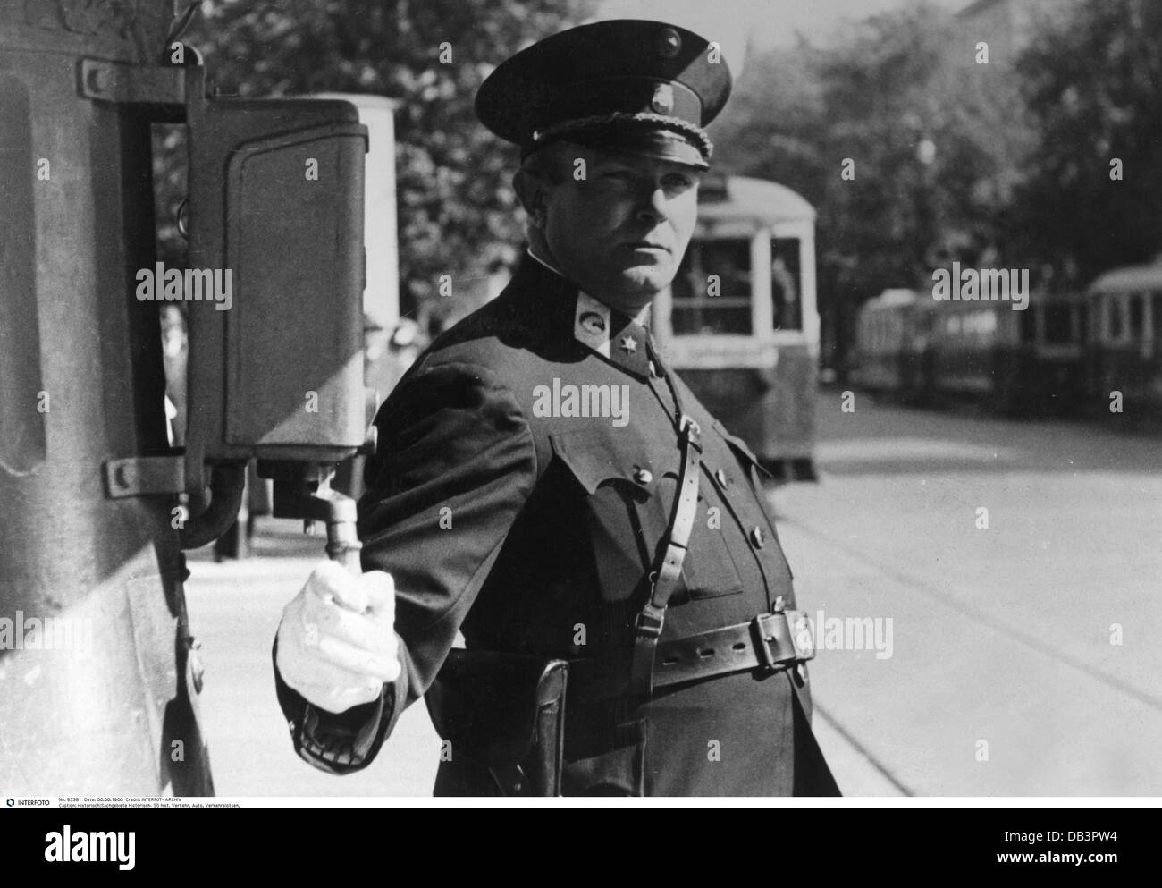 transport / transportation, car, traffic controller, traffic policeman during regulations of the traffic light circuit - Stock Image
