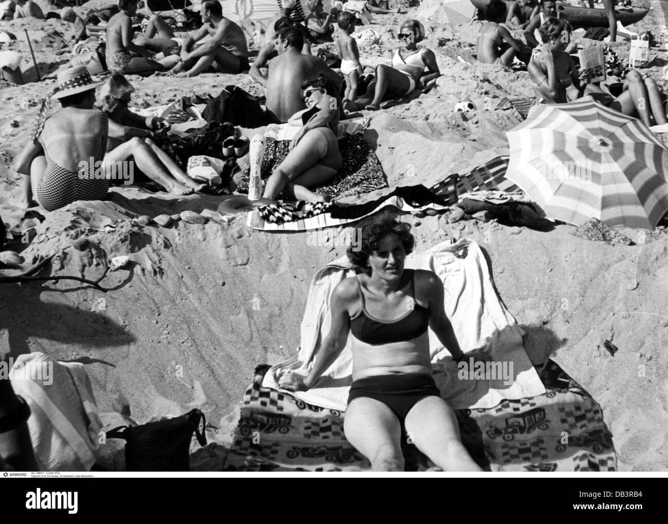 tourism, tourists, beach goer lying on the beach, Italy, 1960s, , Additional-Rights-Clearences-NA - Stock Image