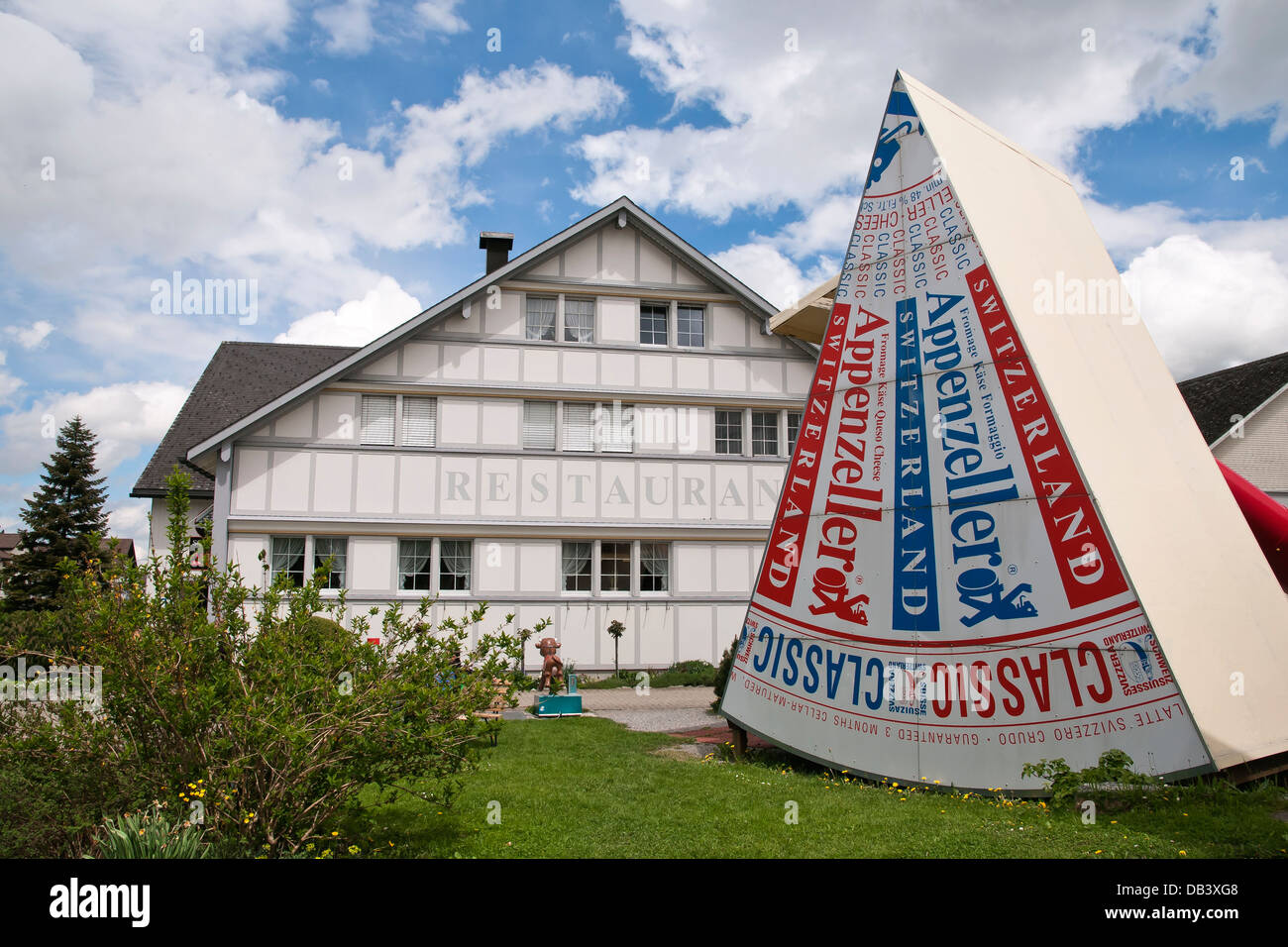 Stand-up ads cheese and restaurant building of Cheese factory, Stein, Appenzell region, Switzerland - Stock Image