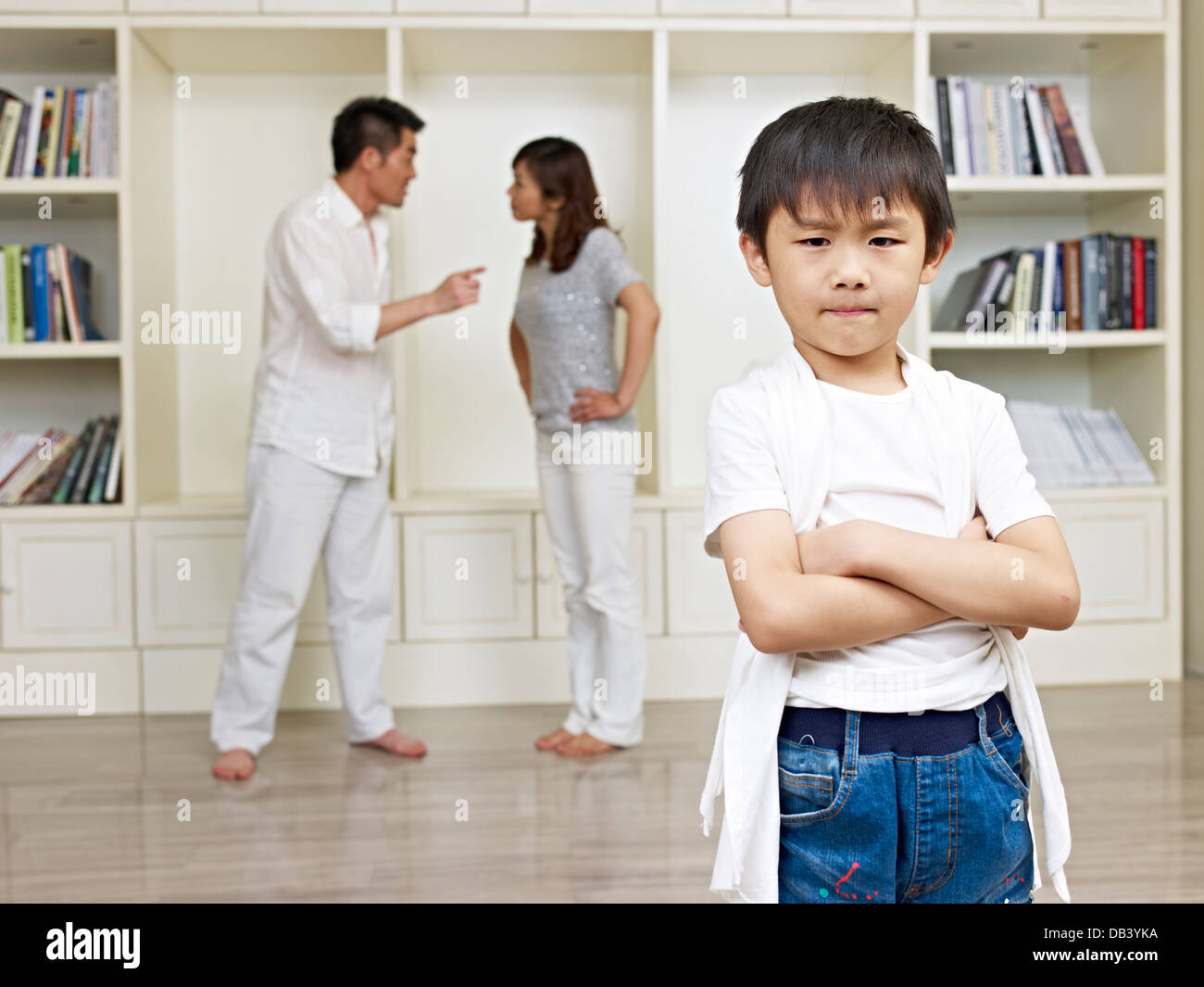 Asian Child and Quarreling Parents - Stock Image