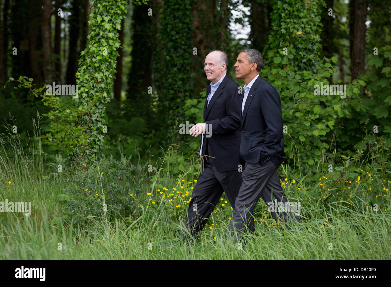President Barack Obama walks with National Security Advisor Tom Donilon on the grounds of Lough Erne Resort at the - Stock Image