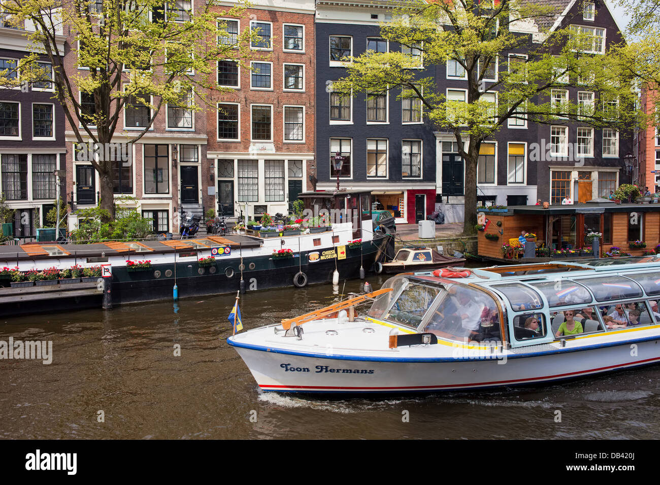 Boat cruise along Prinsengracht canal in city Amsterdam, Holland, Netherlands. - Stock Image