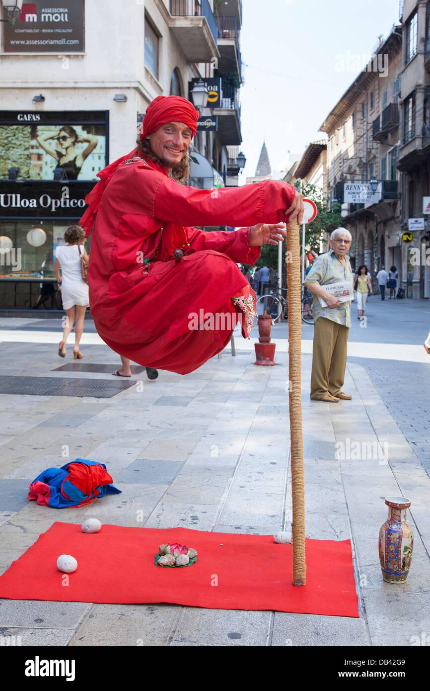 Gravity Defying Street Entertainer in the city of Palma Majorca - Stock Image