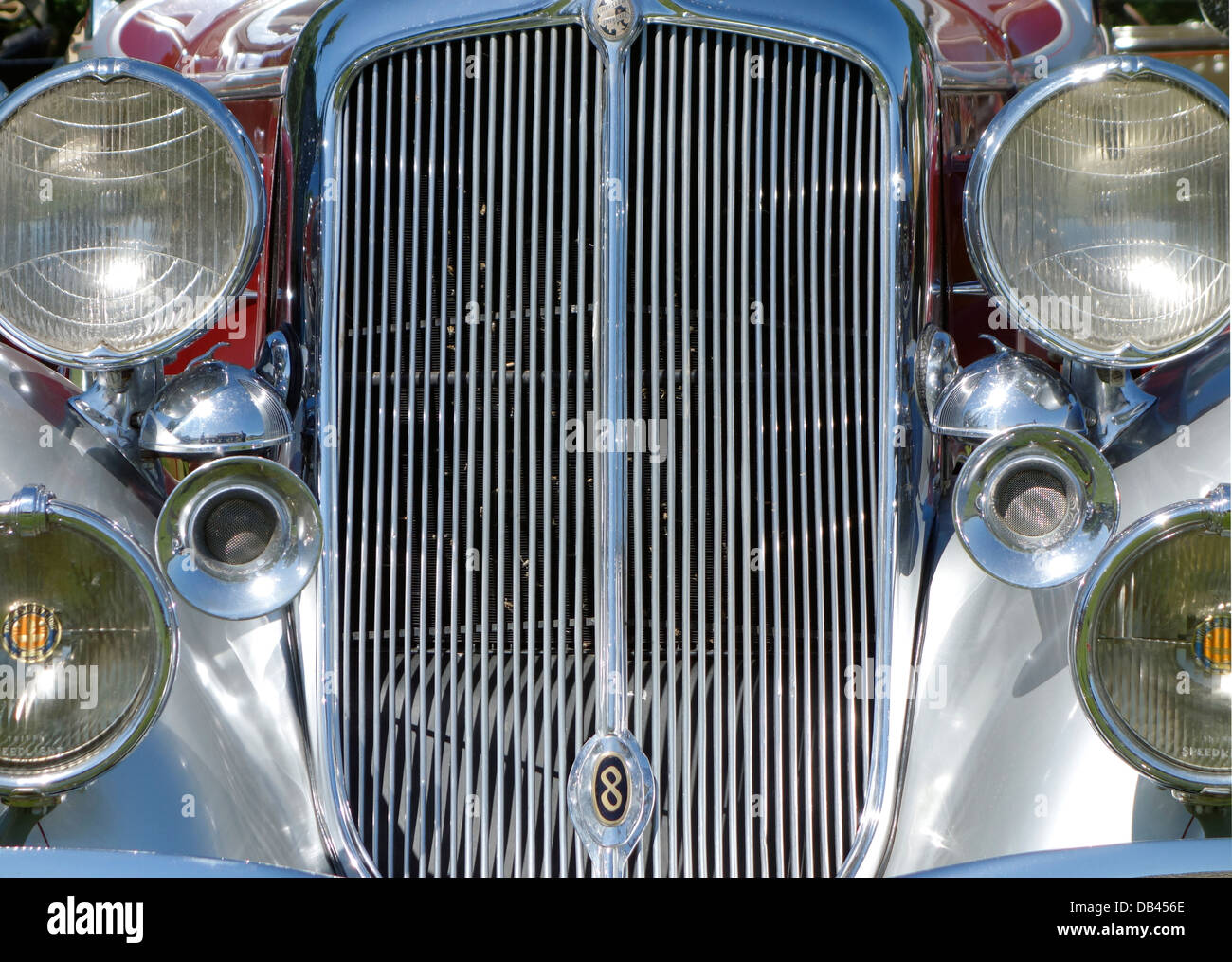 Front view on grills and headlights of antique convertible automobile Chrysler Imperial from early 1930es - Stock Image