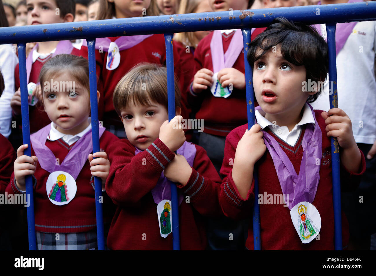 Spanish school children wearing the symbol of Virgin Mary and watching pilgrimage to El Rocio in Andalusia - Stock Image