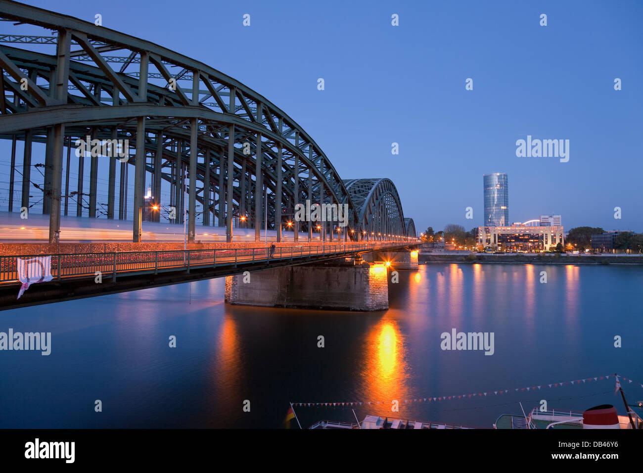 River Rhine and Hohenzollern Brucke (Bridge) at night, Cologne, Rhine-Westphalia, Germany Stock Photo
