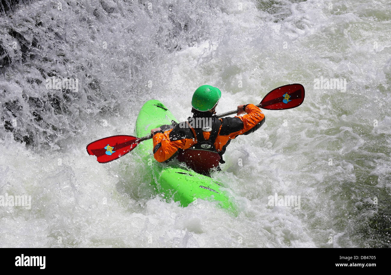 Man Kayaking on whitewater rapids - Stock Image