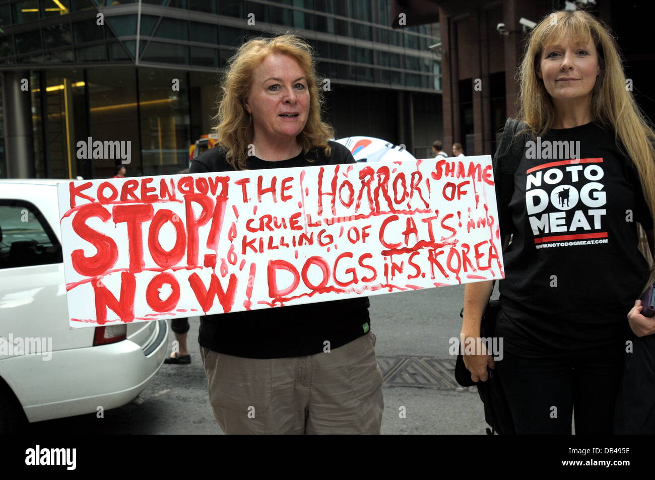 Actives holding placards protest against the South Korea over the next sixty days for the dog eating festival Bokdays - Stock Image