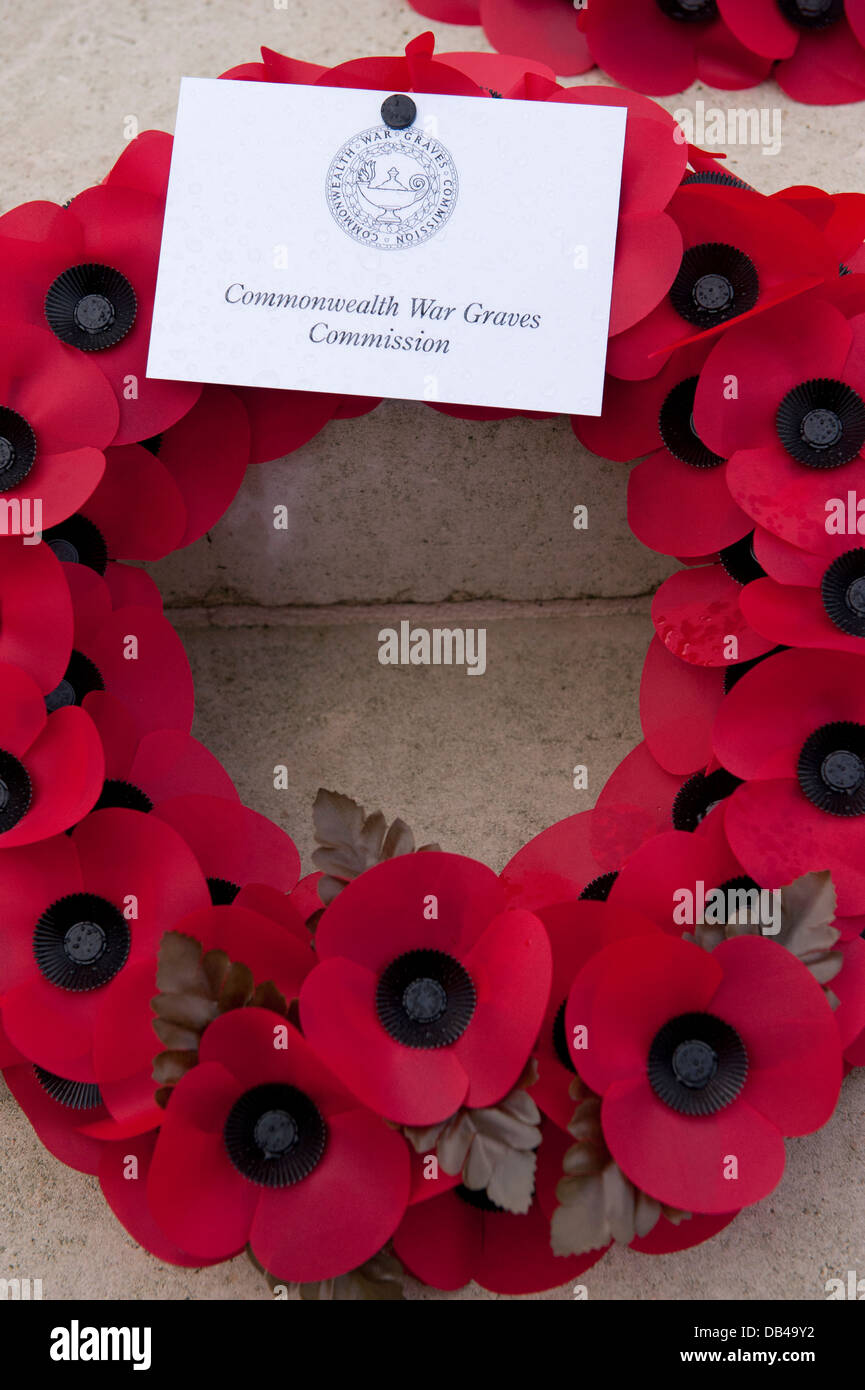 Close-up of circular poppy wreath laid by Commonwealth War Graves Commission (CWGC) at Stonefall Cemetery, Harrogate, - Stock Image