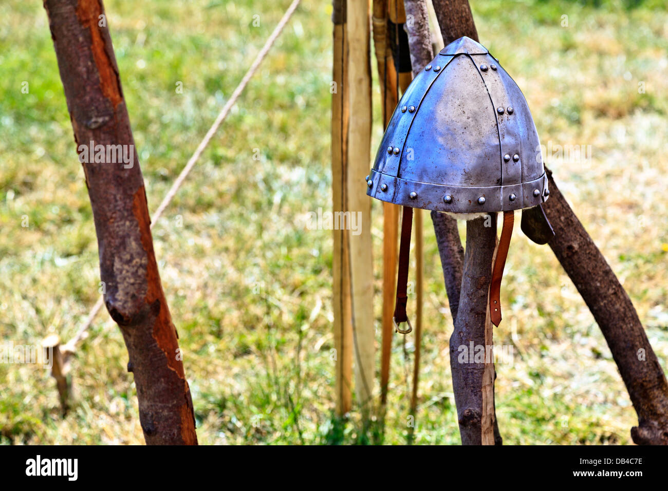 Viking metal helmet sitting on a wooden stake on display at Flag Fen Archaeological Park, Peterborough, England - Stock Image