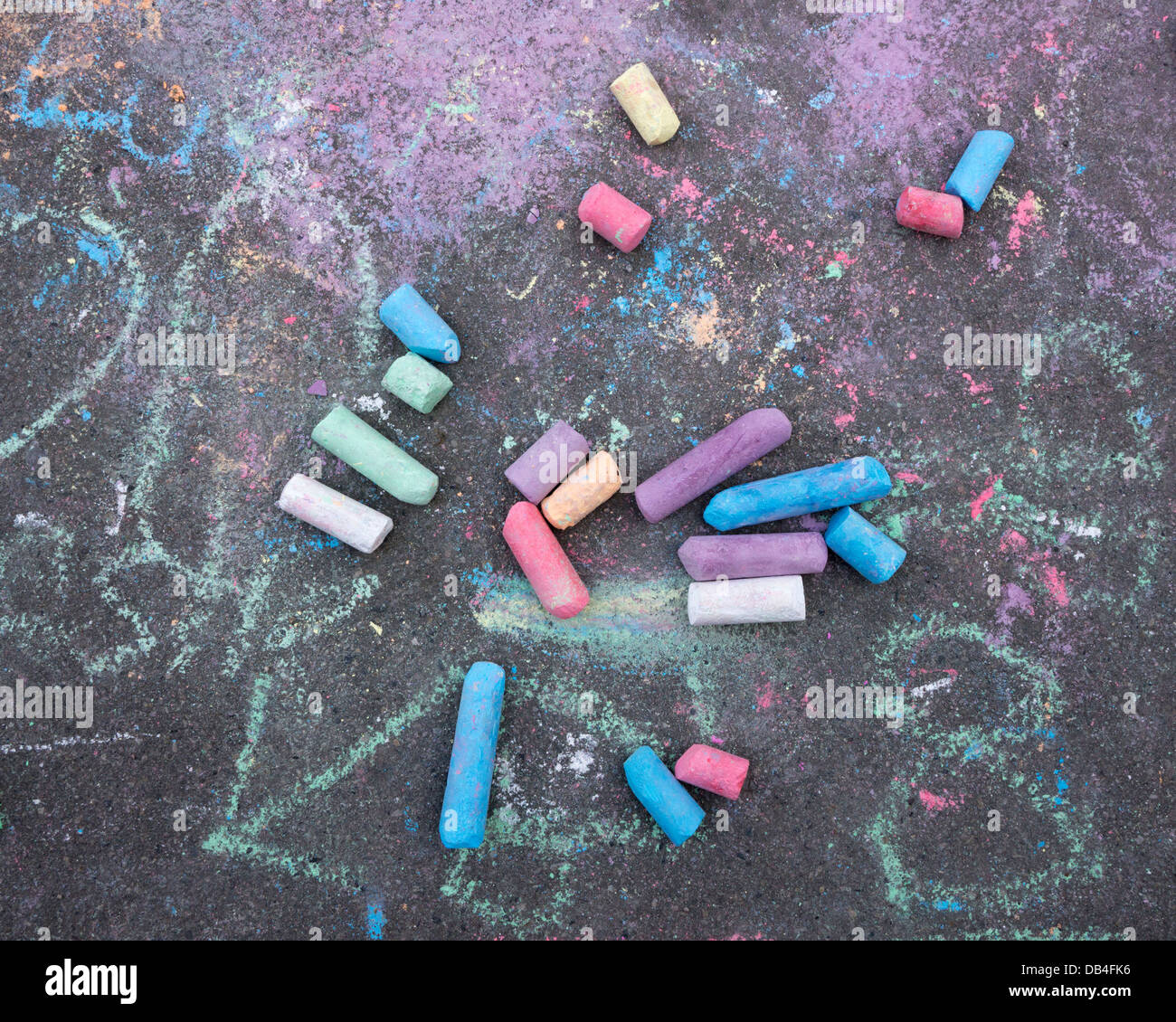 Pieces of chalk on the street - Stock Image