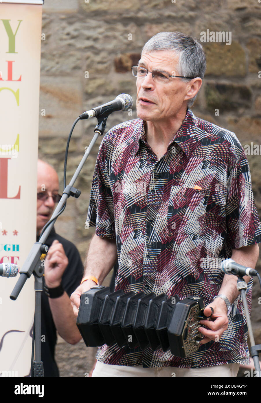 Alistair Anderson plays the concertina at the Rothbury Traditional Music Festival, northern England, UK - Stock Image