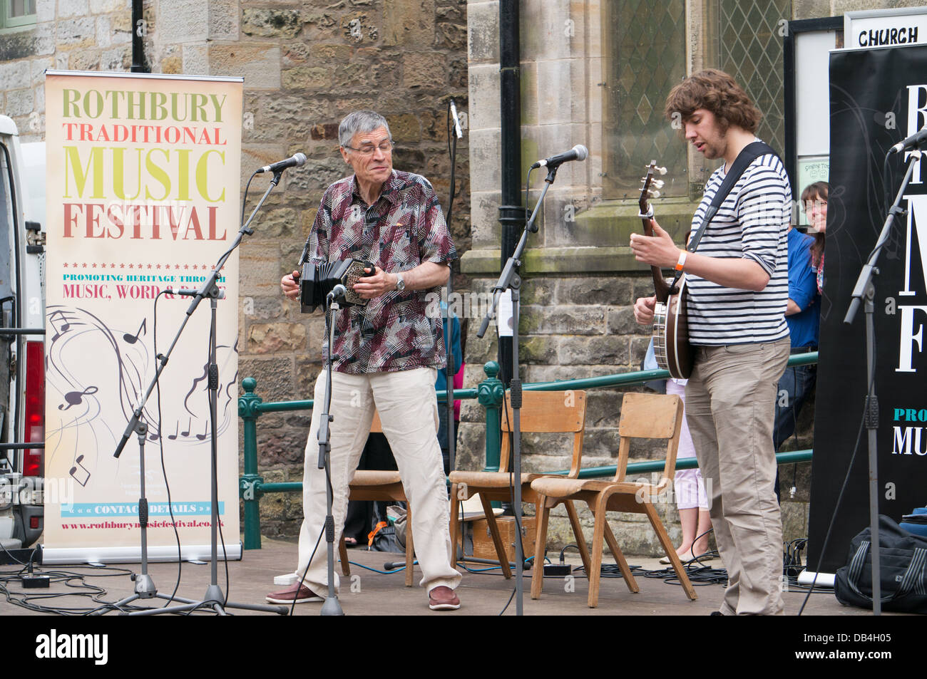 Alistair Anderson on concertina and Dan Walsh on banjo perform at the Rothbury Traditional Music Festival, northern - Stock Image