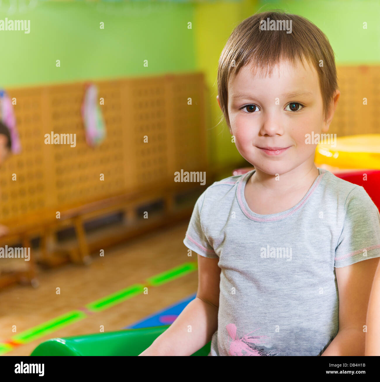Cute little girl portrait in daycare gym Stock Photo