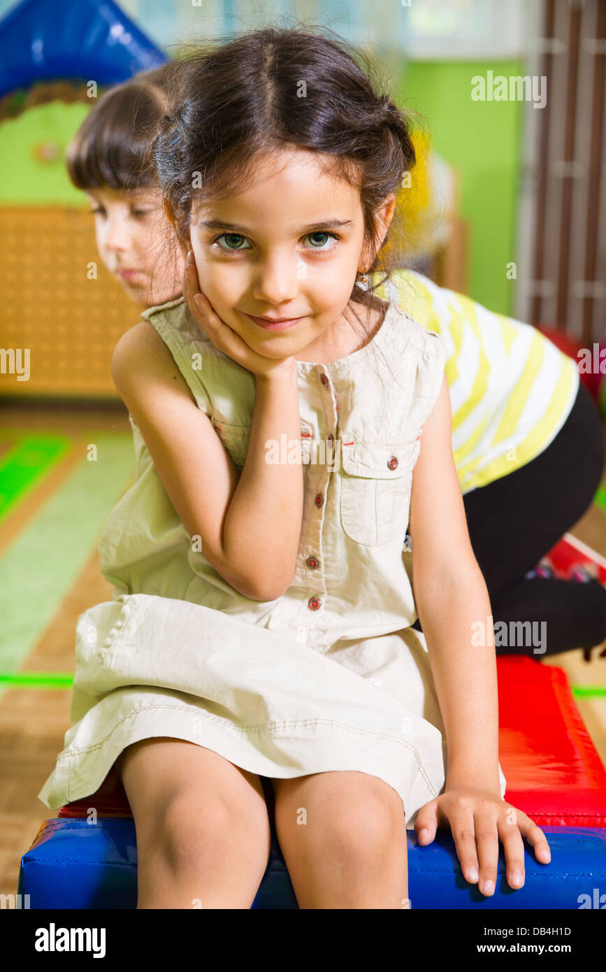 Portrait of little cute latin girl in daycare gym Stock Photo