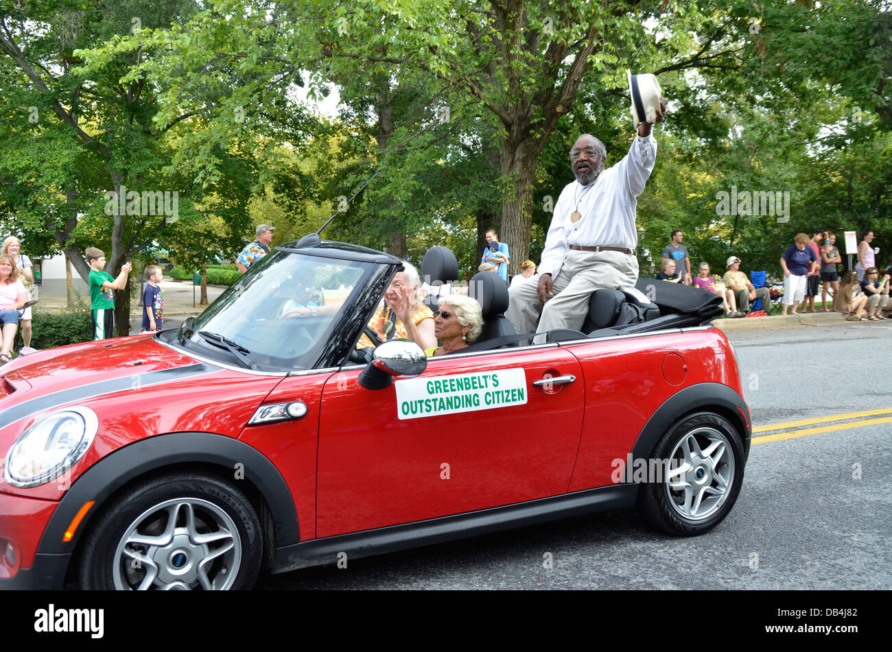 Greenbelt Maryland's outstanding citizen waves to the crowd as he driven in convertible in Greenbelt's Labor - Stock Image