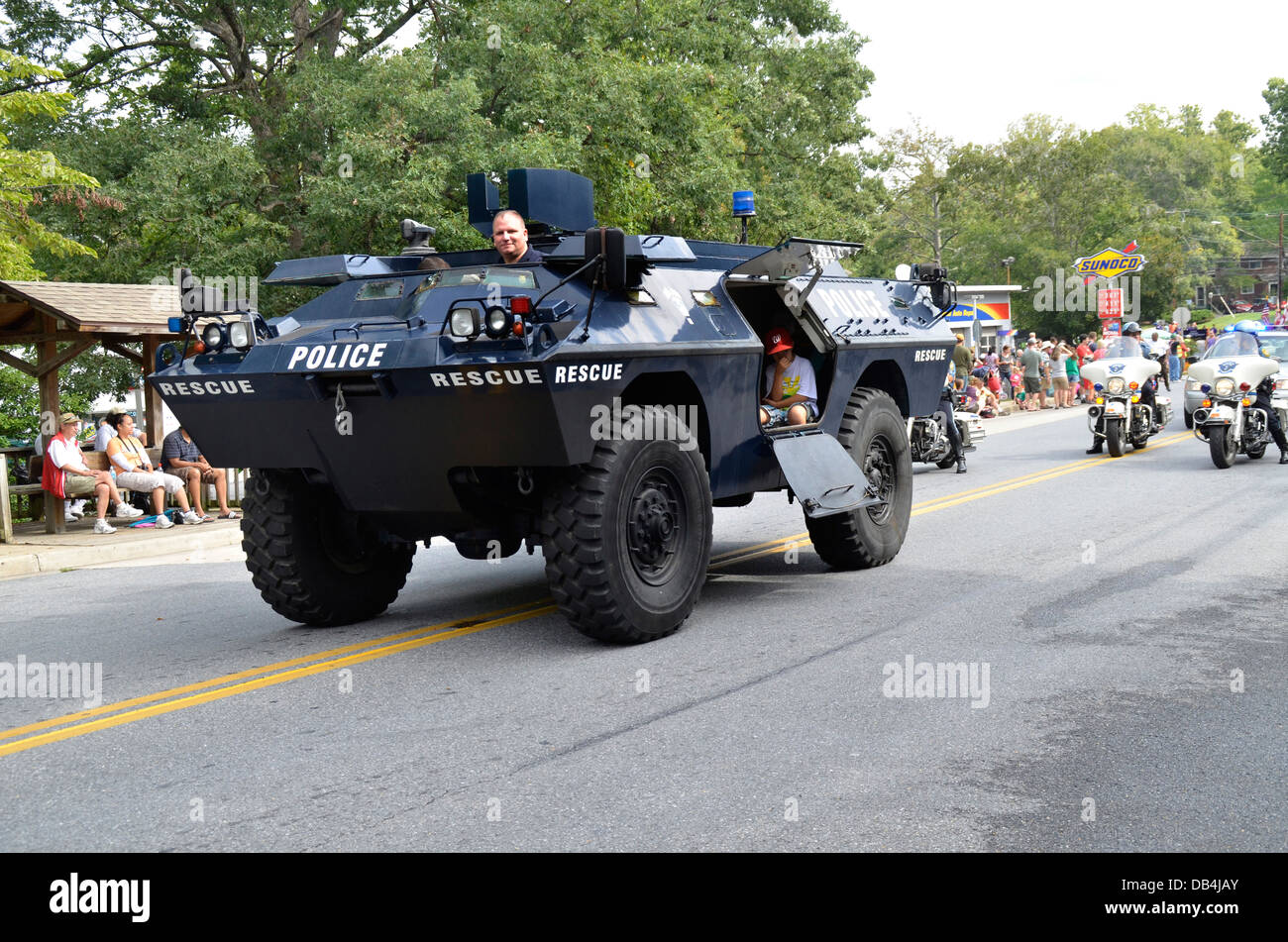 Police armored car in a parade in Greenbelt, Maryland - Stock Image