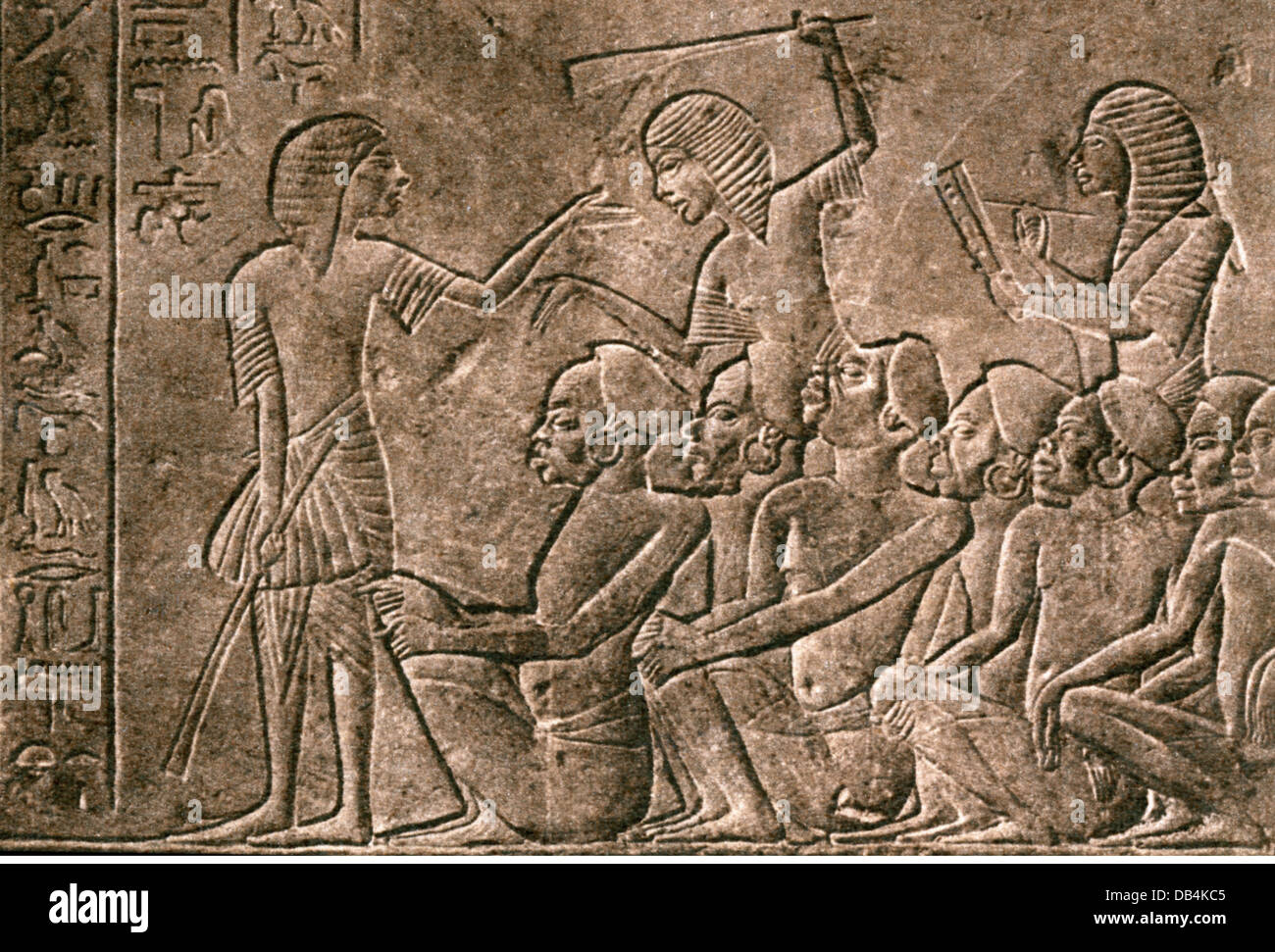 slavery, captured Nubians are registered by a scribe, Egyptian relief, 12th Dynasty (circa 2100 - 1750 BC), suppression, Stock Photo