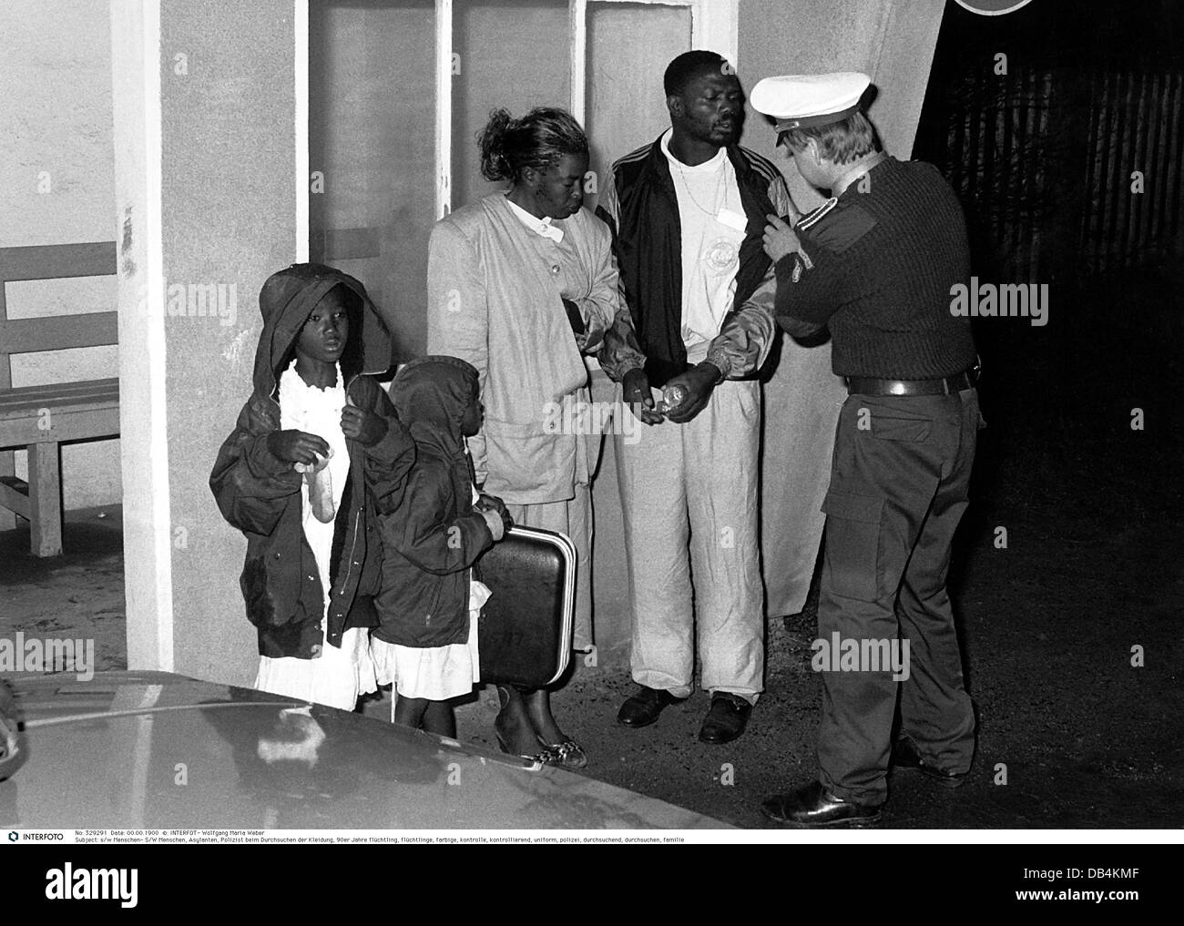 people, asylum seekers, policeman checking clothes, 1990s, , Additional-Rights-Clearences-NA - Stock Image