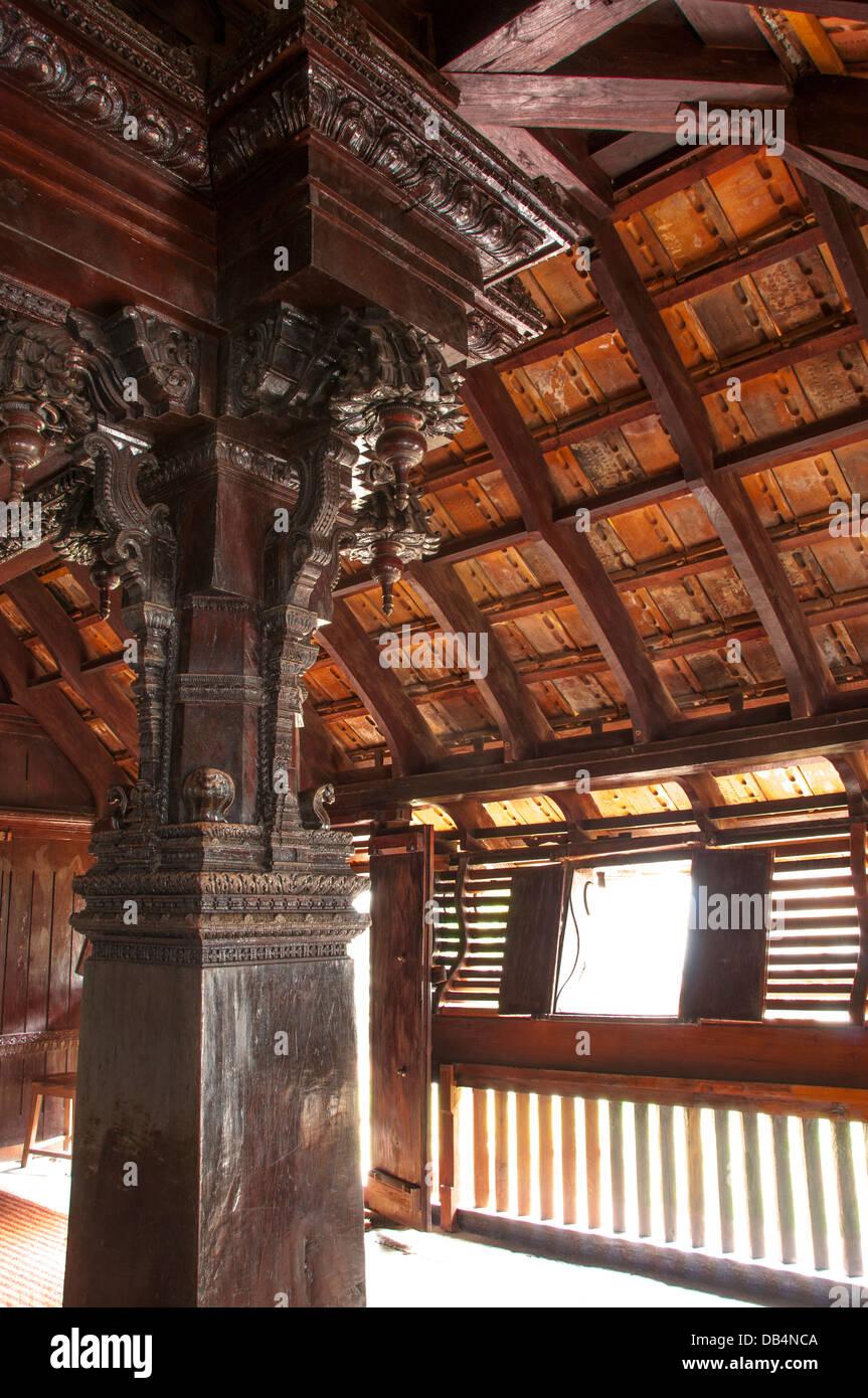 Carving on wooden pillar of single Jackfruit wood, Padmanabhapuram Palace, kerala India Stock Photo