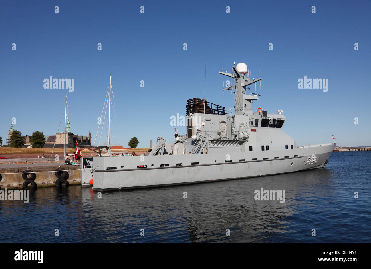 Danish naval ship HDMS Nymfen P524 in the port of Elsinore one sunny summer evening, Denmark. Castle Kronborg in - Stock Image