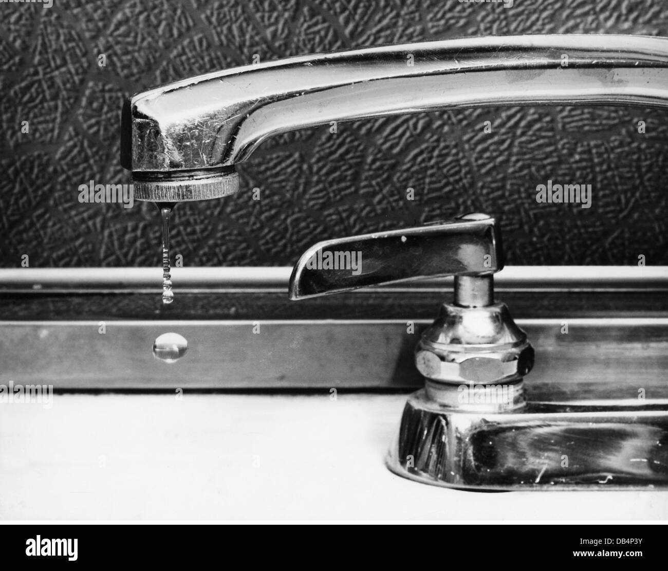 Tap Dripping Water Black and White Stock Photos & Images - Alamy