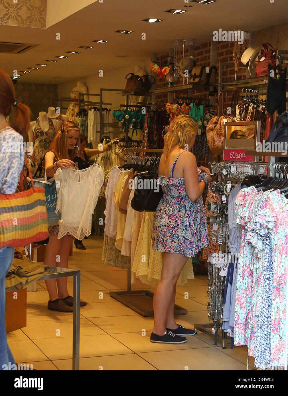People shop in King's Road branch of clothes shop Warehouse, where Kate Middleton bought four items - perhaps - Stock Image