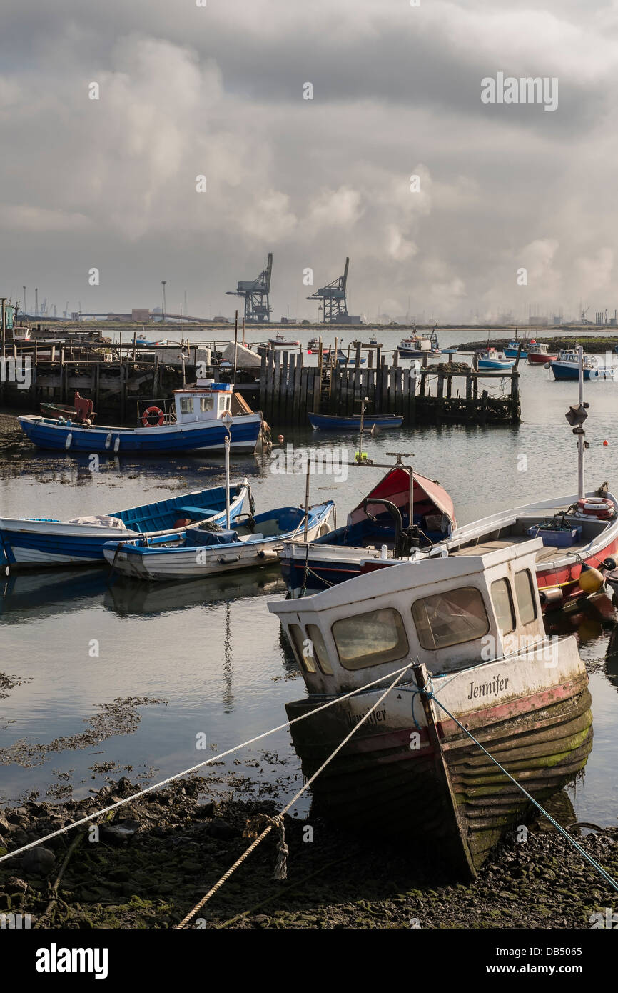 Paddy's Hole, South Gare, Redcar, North Yorkshire, England with Teesside docks in the background - Stock Image