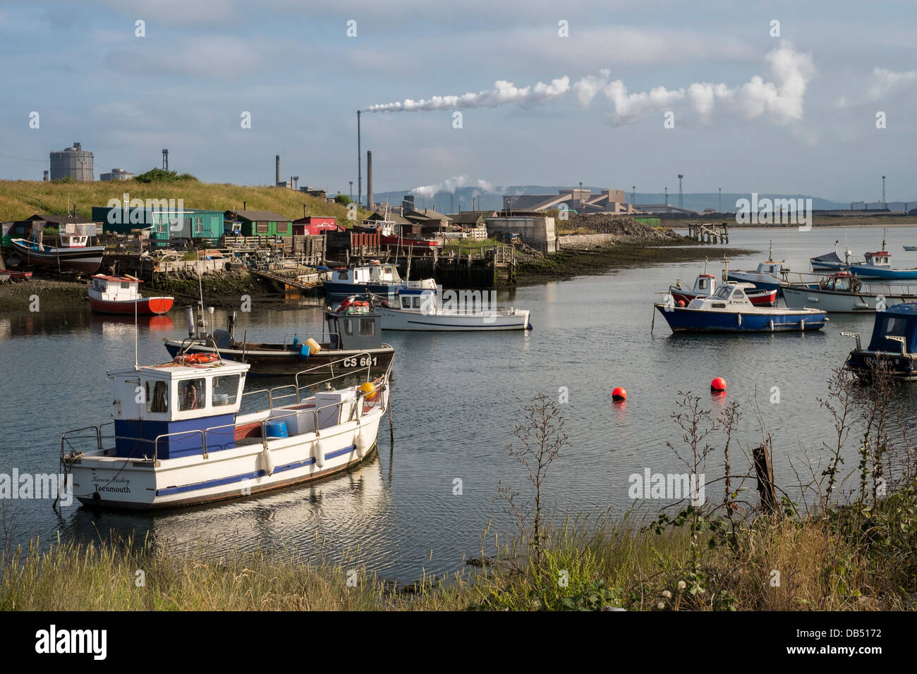 Paddy's Hole with Redcar steel works in the background - Stock Image