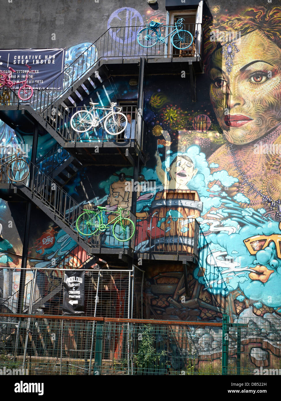Ridelow bicycle shop advert with mural in Manchester UK - Stock Image
