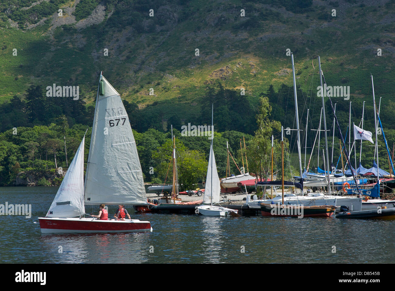 Sailing boat and Glenridding Sailing Club, Ullswater, Lake District National Park, Cumbria, England UK - Stock Image
