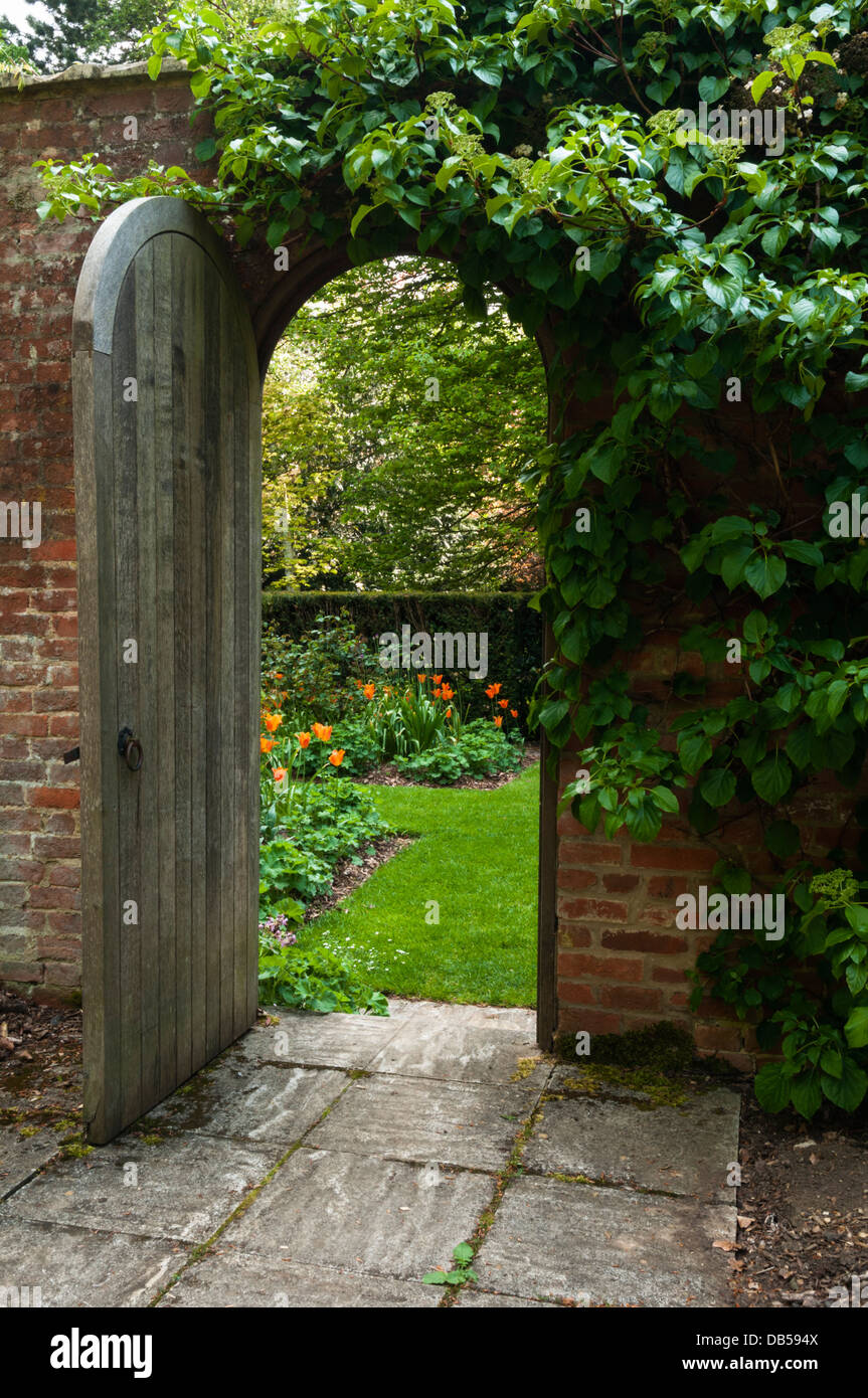 An open wooden garden door provides a \u0027Secret Garden\u0027 view