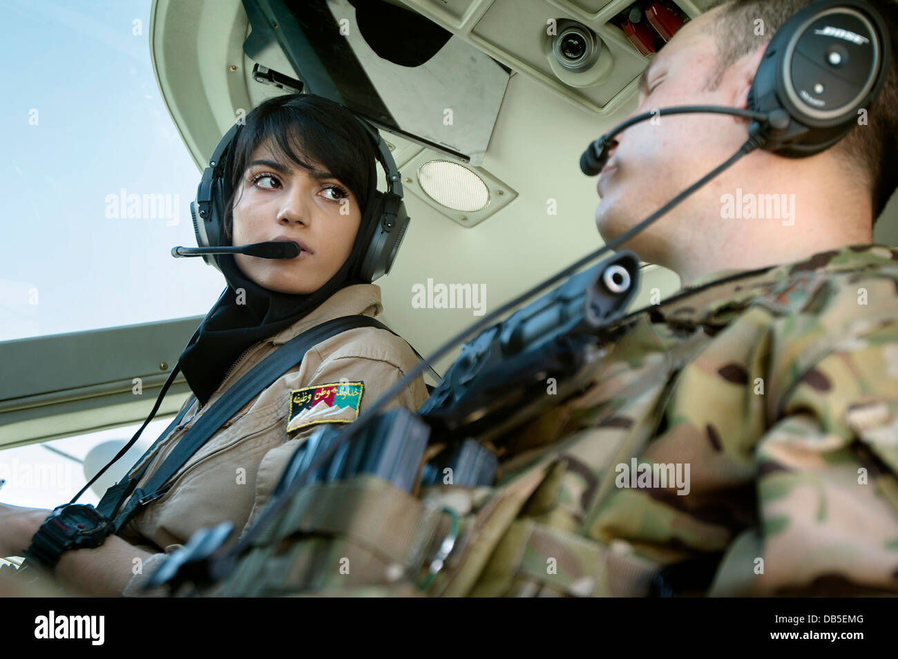 Afghan National Army Air Force 2nd Lt. Niloofar Rhmani, left, a pilot with the Kabul Air Wing and US Air Force Capt. - Stock Image
