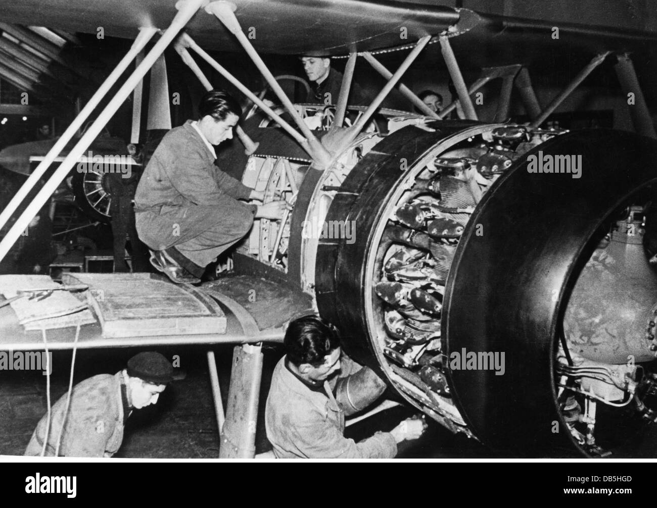 events, Second World War / WWII, Italy, armaments industry, aircraft engine Fiat A.74 is mounted to a fighter biplane - Stock Image