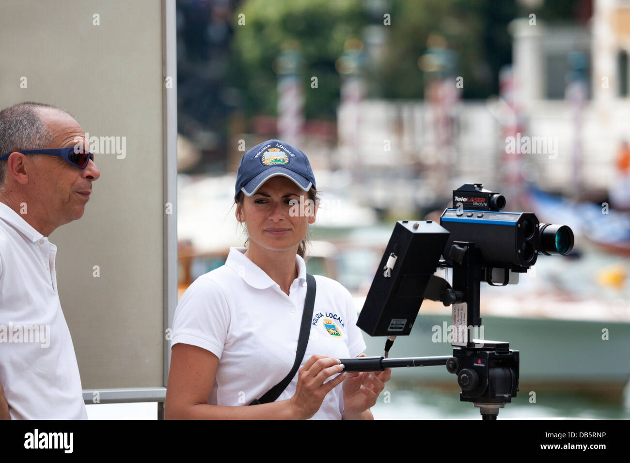 In Venice, local policemen checking the allowed boat speed on the Grand Canal with the help of a radar speed camera - Stock Image