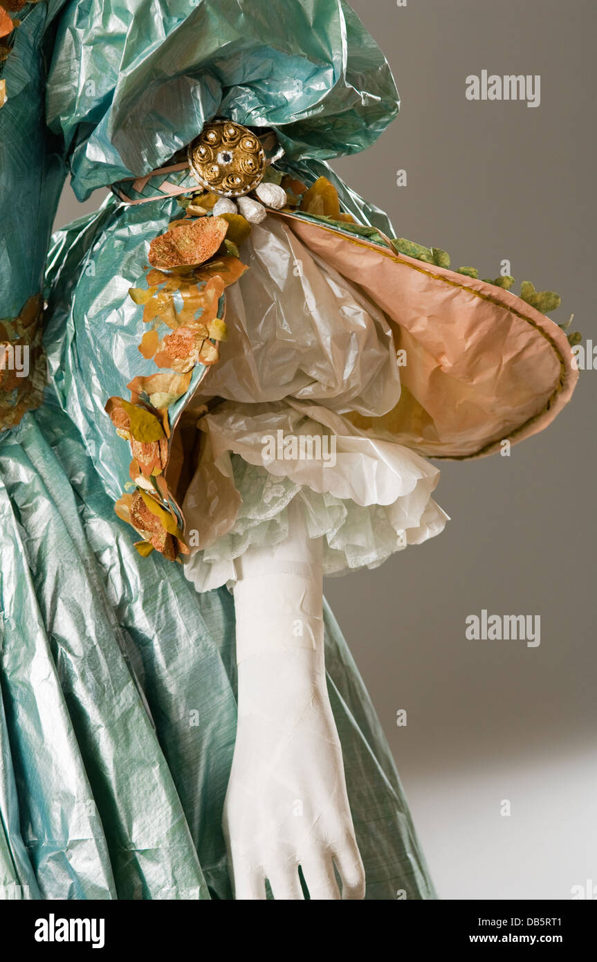 Sleeve detail of mannequin in paper dress costume - Stock Image