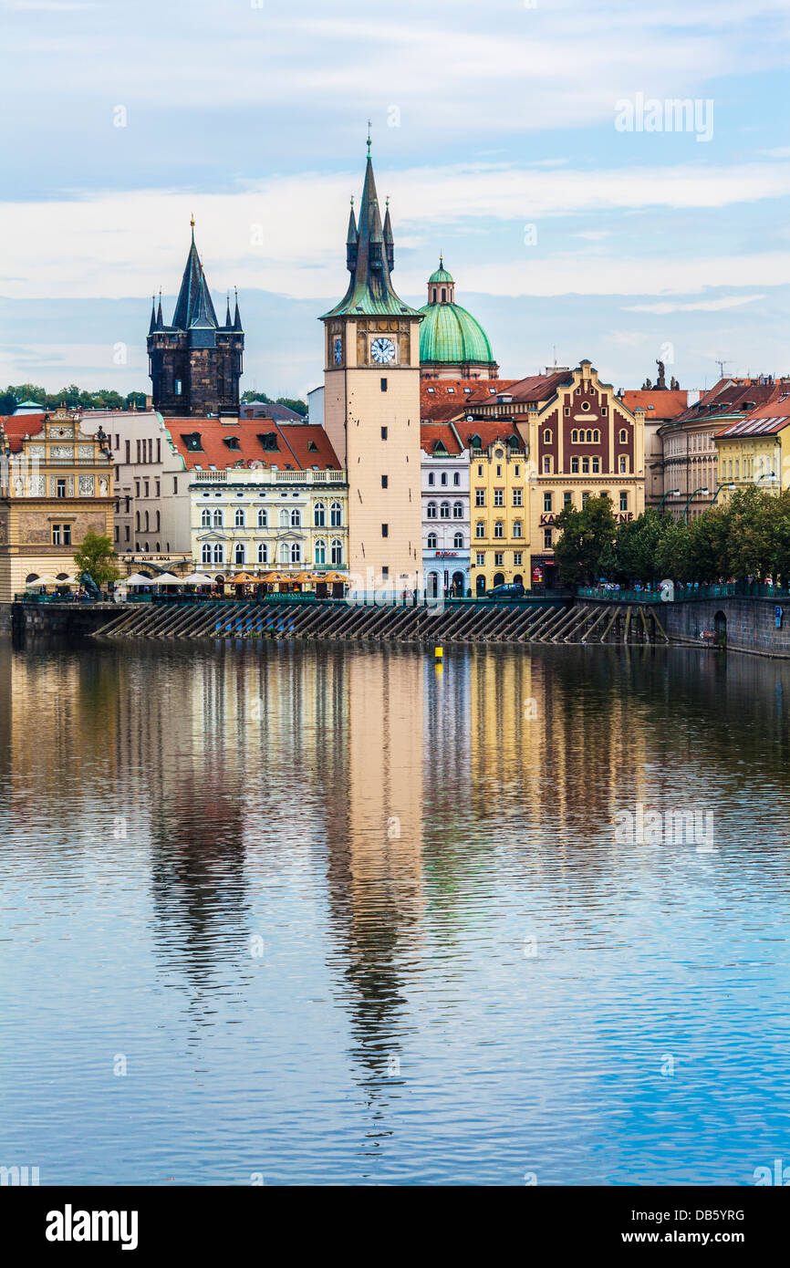 Prague's old architecture reflected in the water of the river Vltava or Moldau. - Stock Image